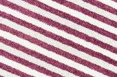abstraktní červeně a bíle pruhované textilní textury