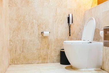 White bowl seat decoration in toilet room interior