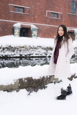 Beautiful young asian woman smile and happy with travel trip in