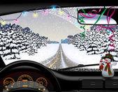Zimní cesta v sněžení od uvnitř vozu