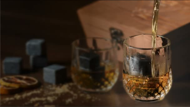 Pouring A Scotch Whiskey To Glass On The Rocks