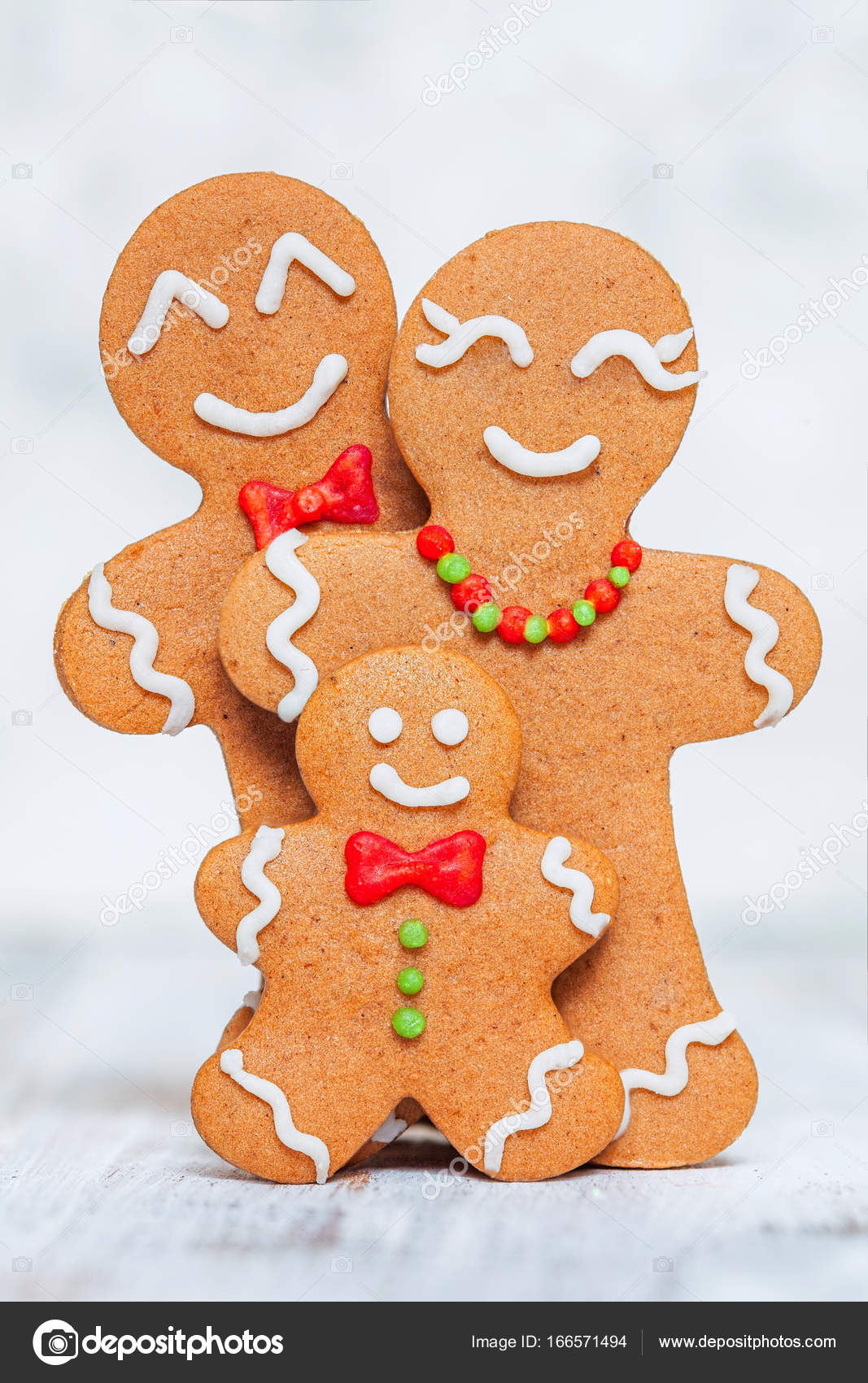 christmas decoration with happy gingerbread man family with kid photo by odelinde