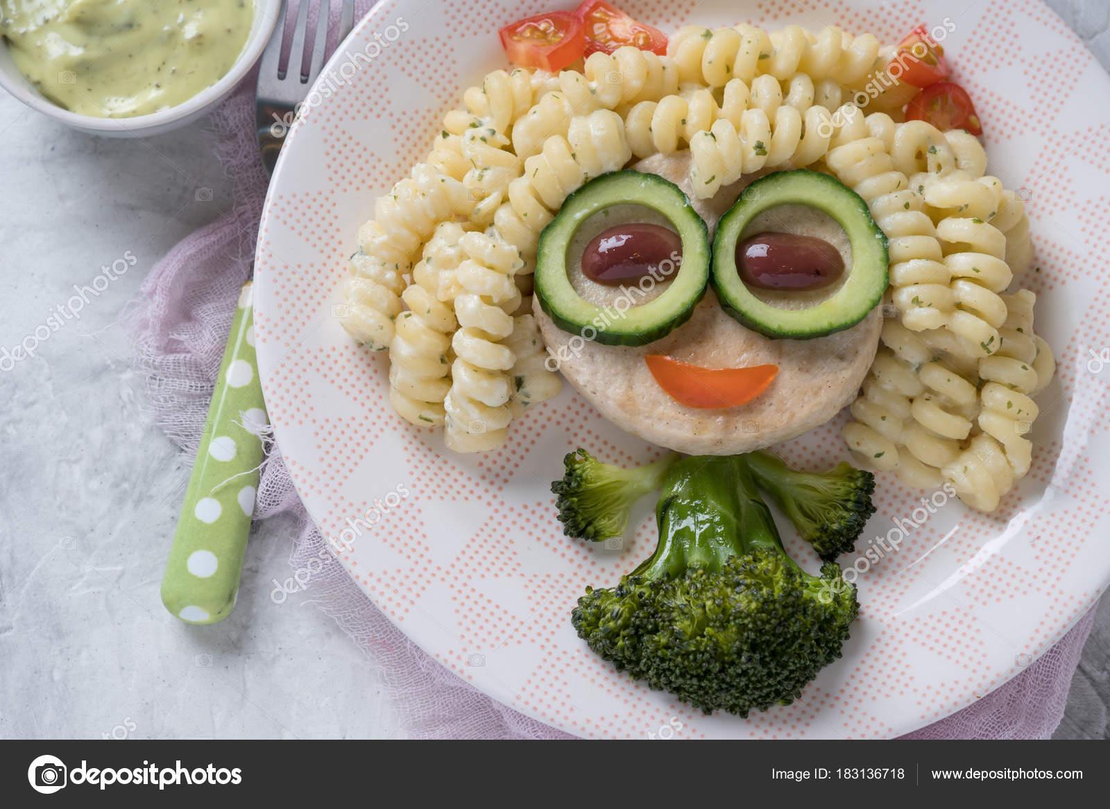 funny girl food face with cutlet pasta and vegetables stock photo odelinde 183136718. Black Bedroom Furniture Sets. Home Design Ideas