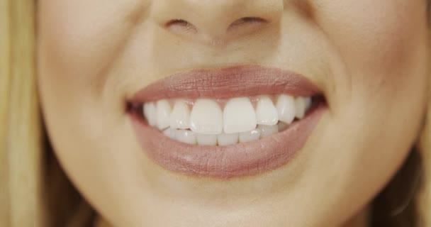 Closeup view of woman with perfect white teeth smiling