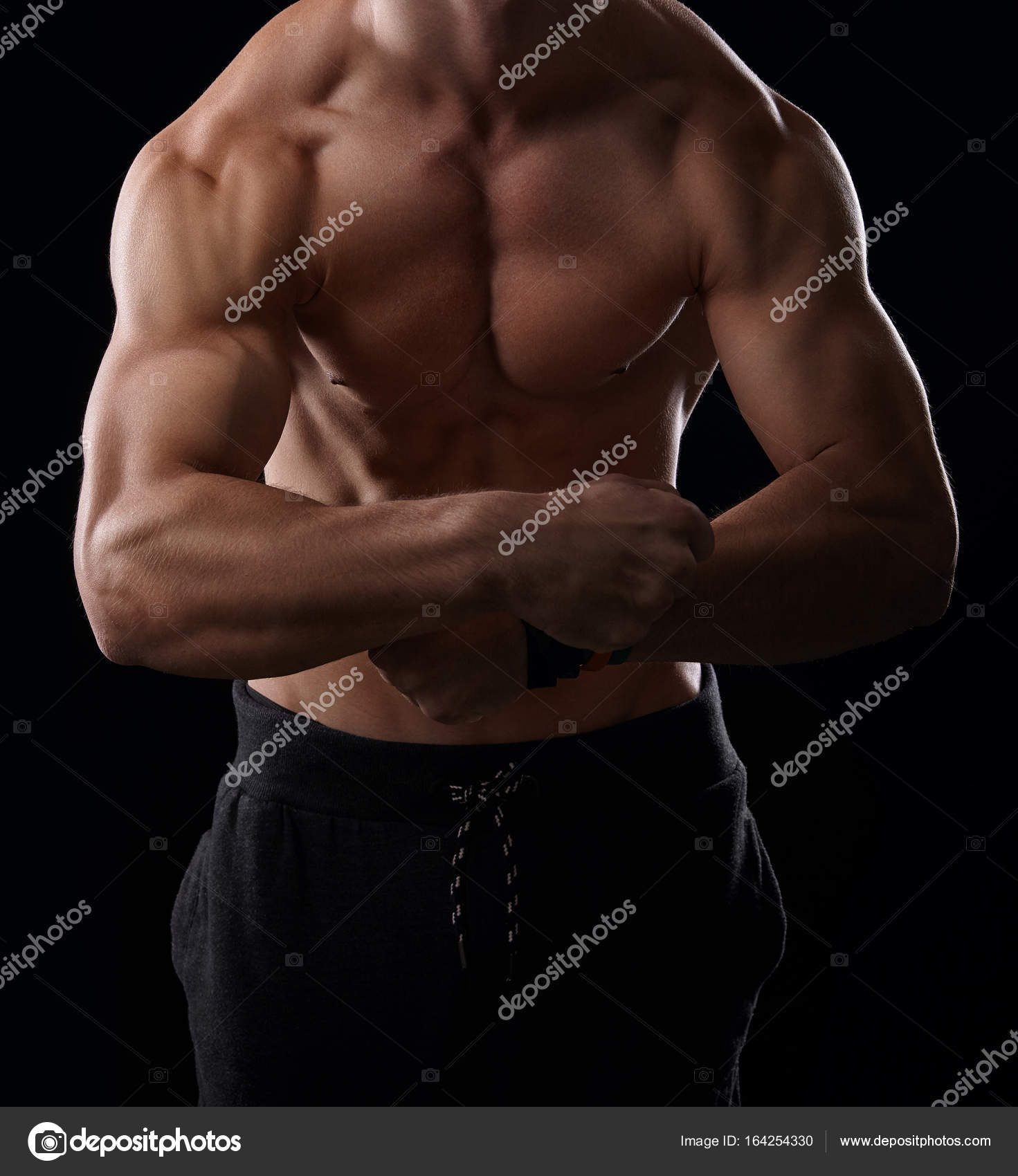 Muscular Man Showing His Muscular Arms Stock Photo Cherriesjd