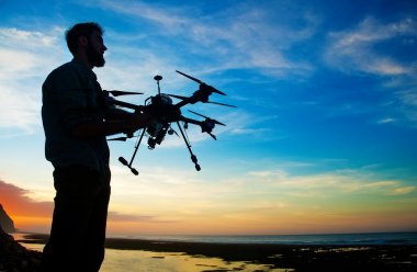 man holding drone for aerial photography