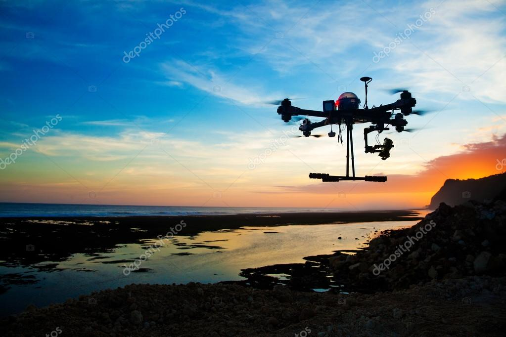 drone silhouette against sunset sky
