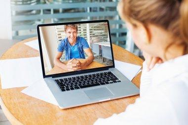 woman and man talking on web camera