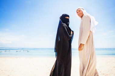 muslim couple on beach