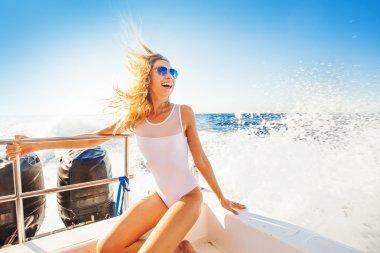 woman sailing boat