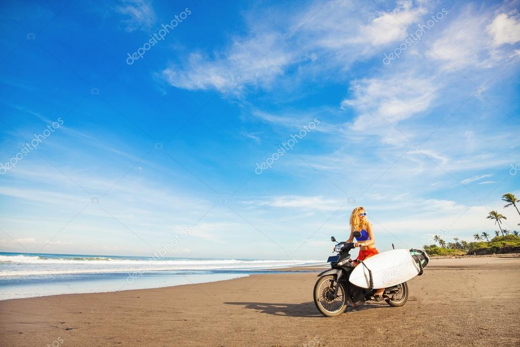 girl surfer on beach
