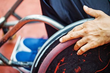 hand on a wheel of a wheelchair