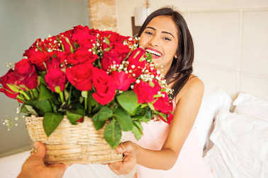 young indian woman holding roses