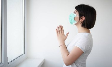 Girl in a medical mask on her face