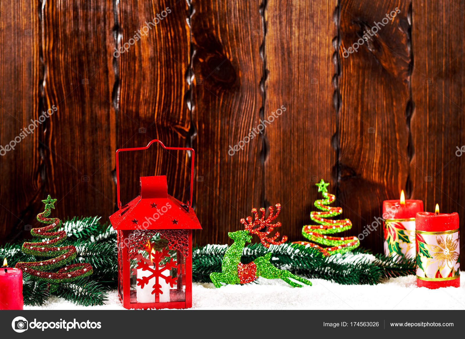 christmas and new year background with christmas candle lantern and christmas tree branches snow and decorations wooden wall behind
