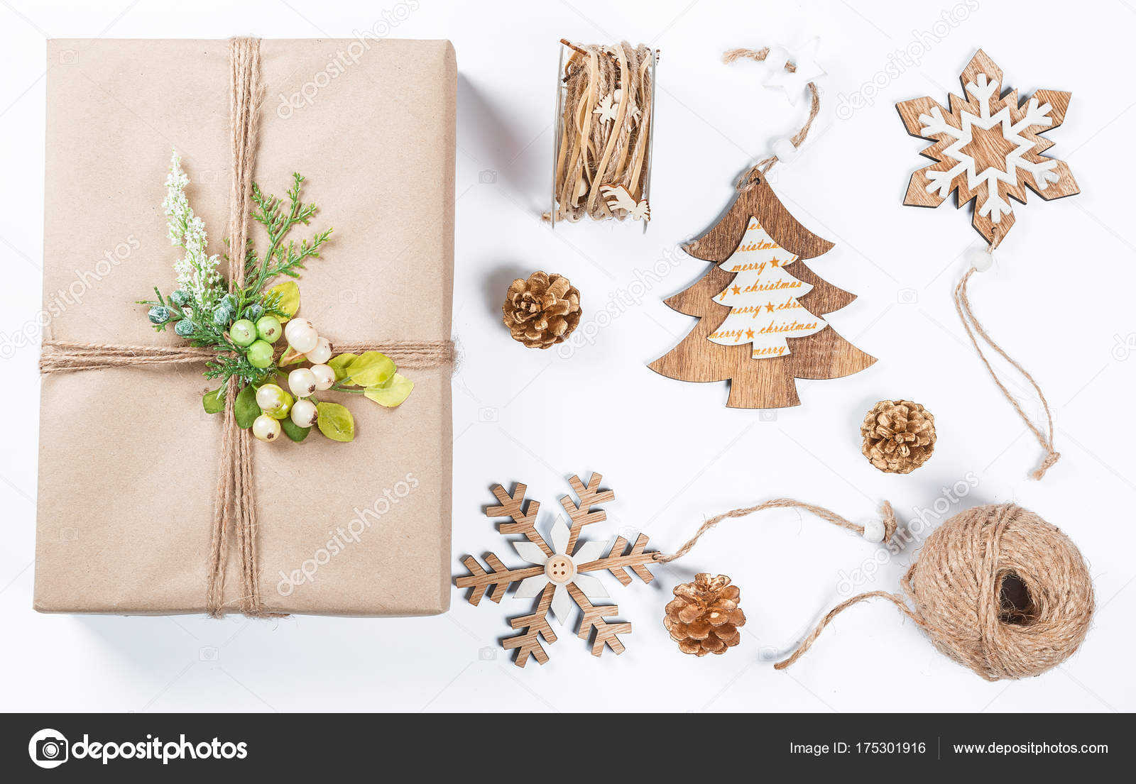 classy christmas gifts box presents in brown paper with toys and new year decor on white merry christmas card background photo by lilichka2015