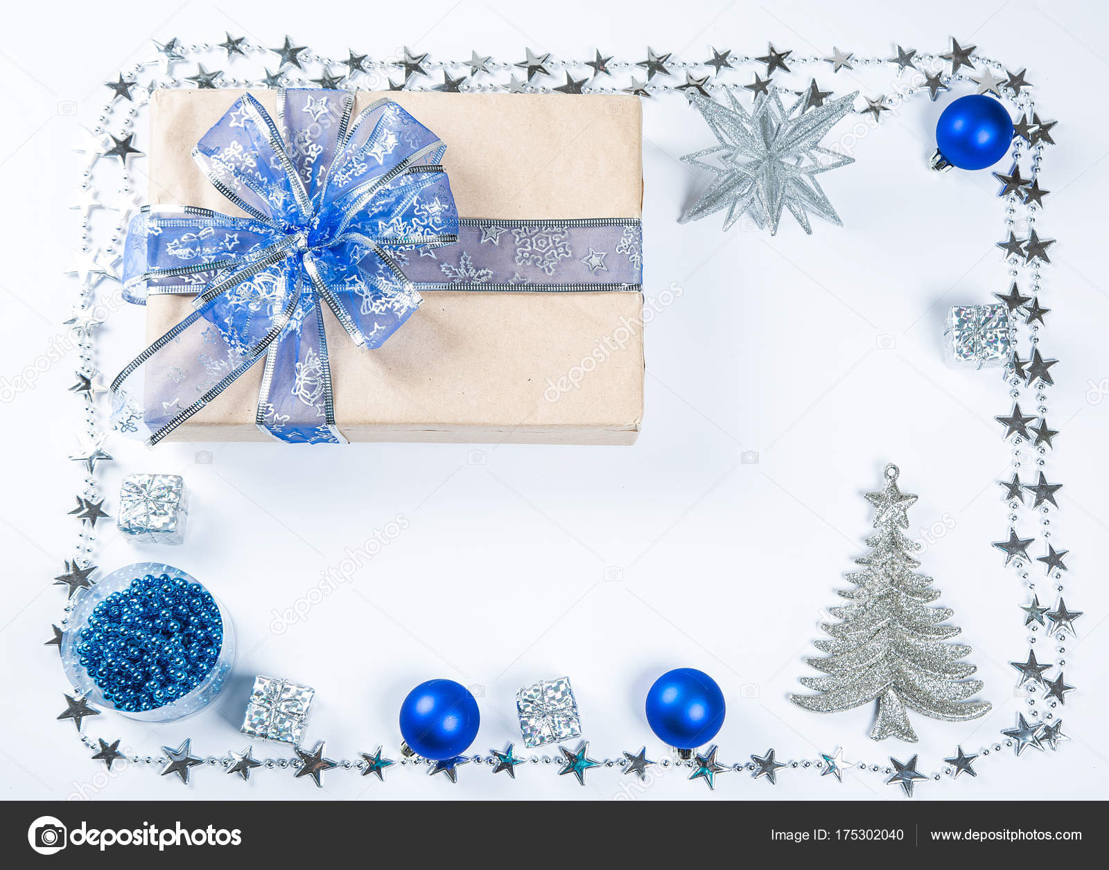 classy christmas gifts box presents in brown paper with blue toys and new year decor on white merry christmas card background photo by lilichka2015