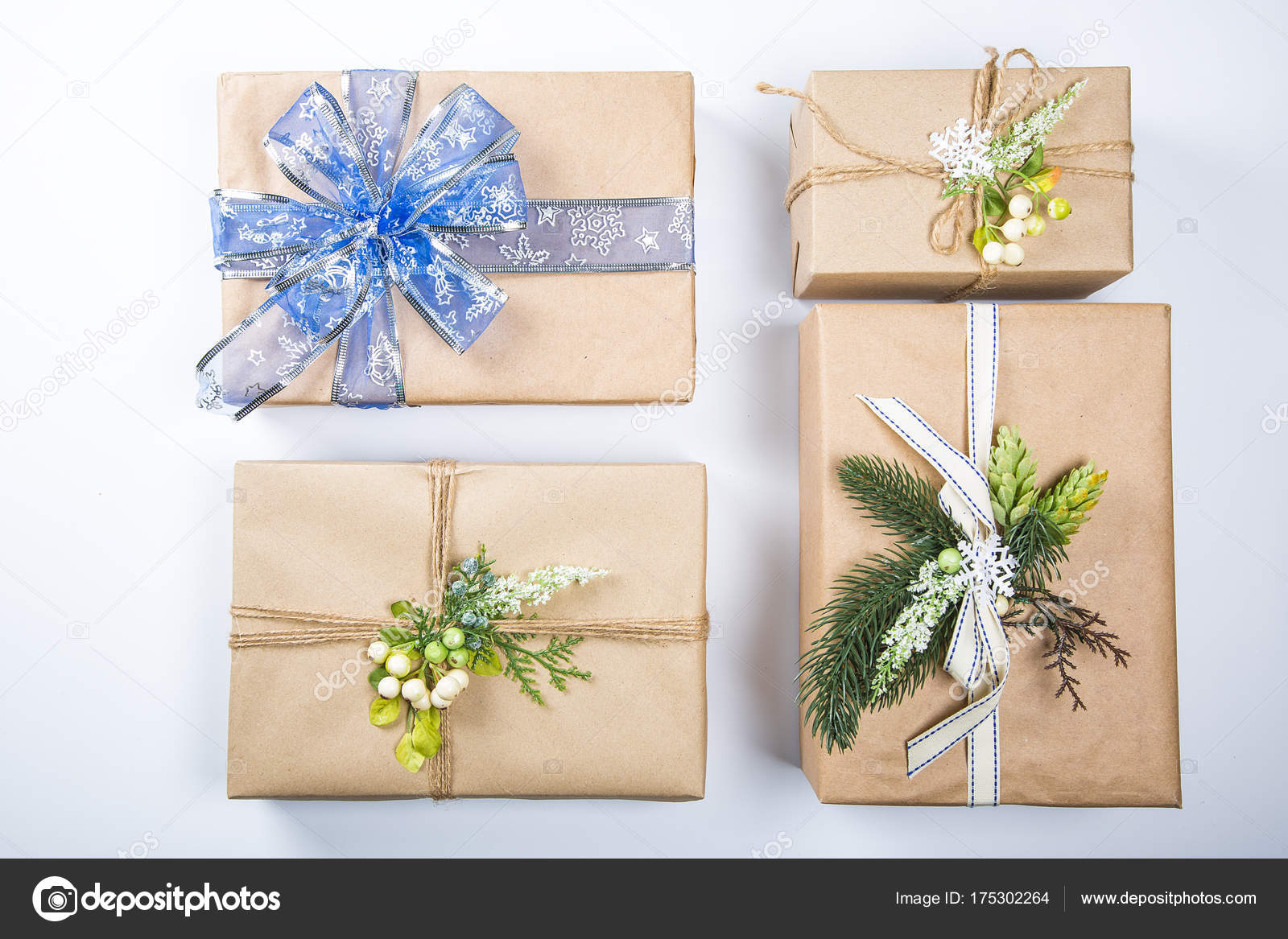 classy christmas gifts box presents in brown paper new year decor on white merry christmas card background photo by lilichka2015