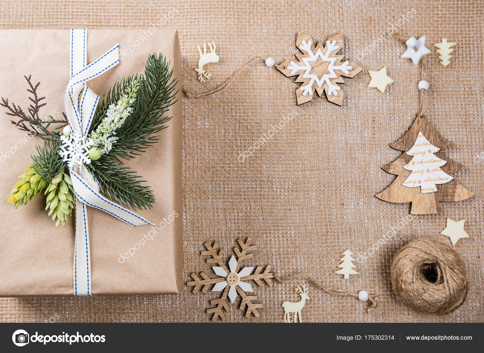classy christmas gifts box presents in brown paper with toys and new year decor on burlap merry christmas card background photo by lilichka2015