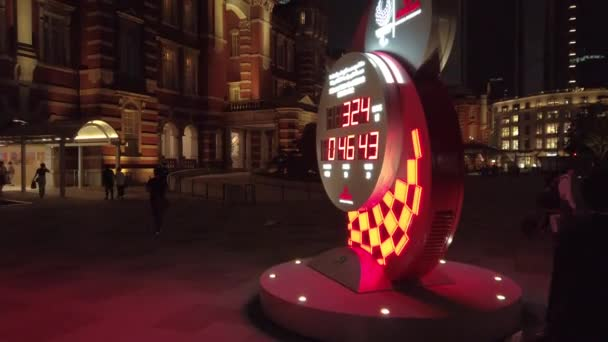 Video of the Official olympic timekeeper Omega countdown clock for the Olympic and Paralympic Games Tokyo 2020 in front of the Tokyo Station at night.