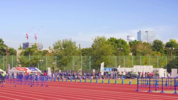 Pan video of an event called Japan Walk in Tokyo 2019 Autumn organised for the 2020 Tokyo Olympic and Paralympic Games where participants can walk together and enjoy sports for people with disabilities.