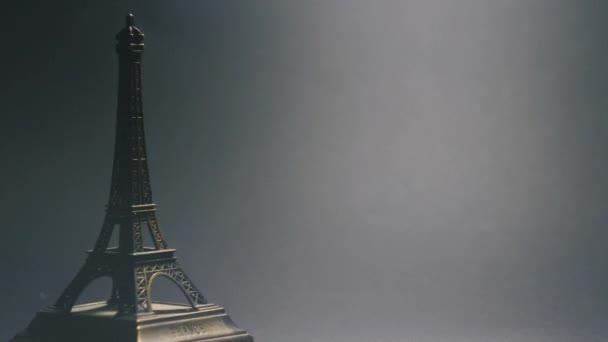 Eiffel tower toy model on dark grey background