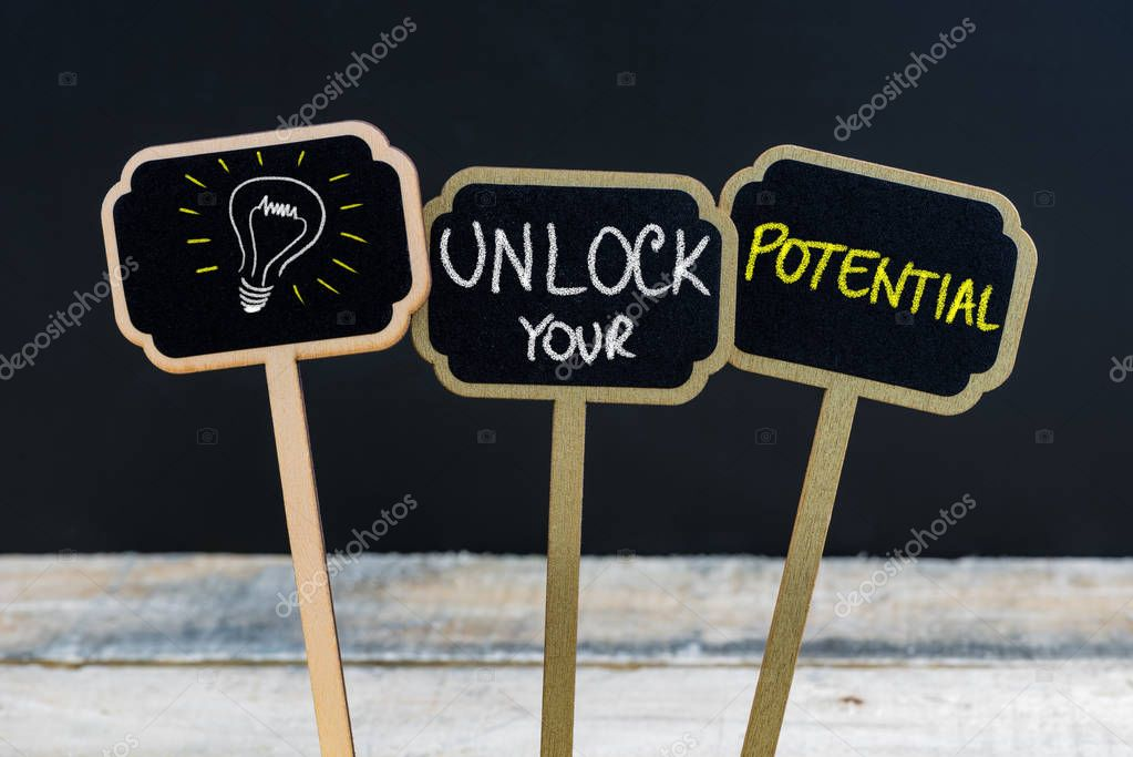 Concept Message Unlock Your Potential And Light Bulb As Symbol For