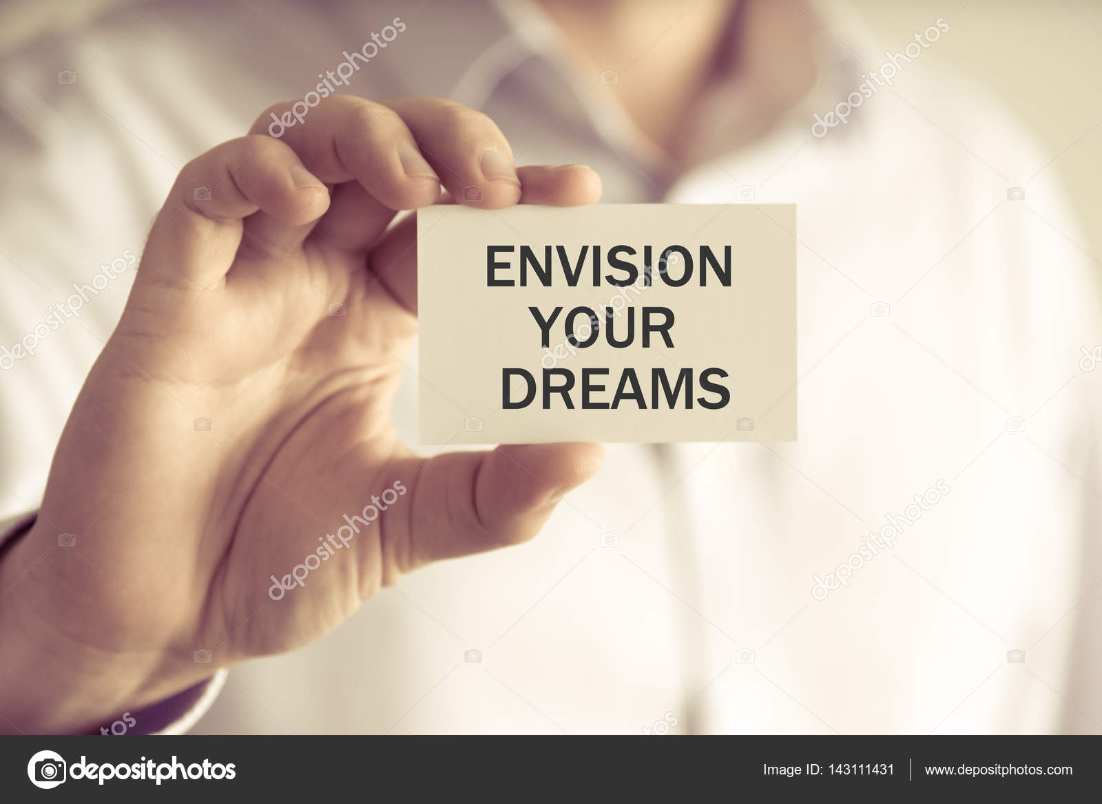 Businessman holding ENVISION YOUR DREAMS message card — Stock Photo ...
