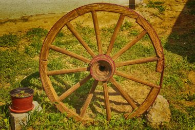 Old wooden wheel of the wagon