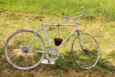 Vintage Bicycle as Support for Flowerpot