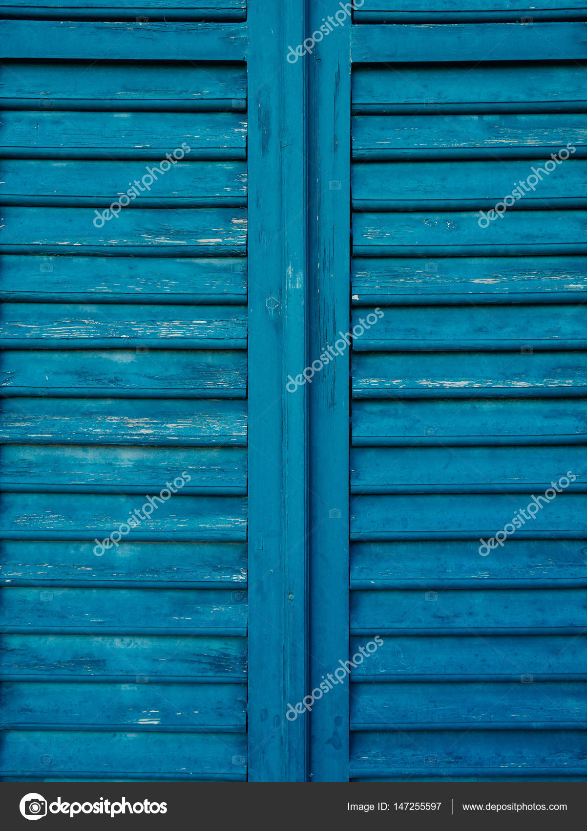 Wooden window shutters in blue. Antique homemade shutters on the — Stock Photo