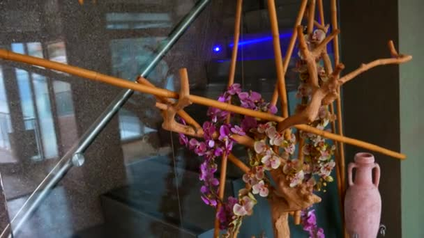 Elements interior design. Wooden snag with flowers.