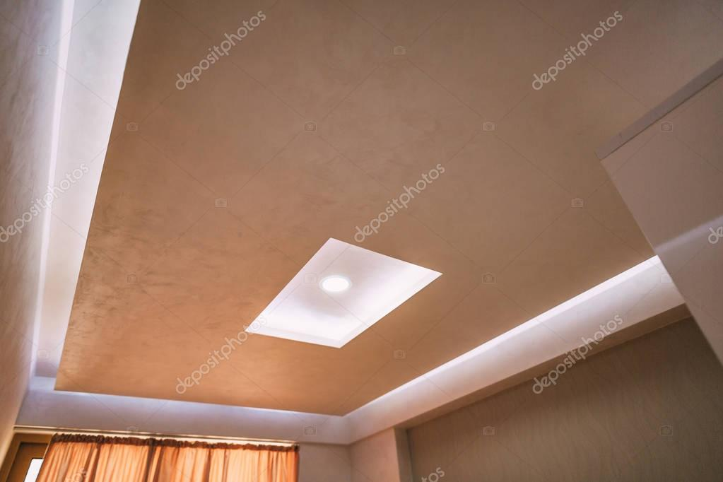 Stretch ceiling film. The design of the apartment. Renovated apa