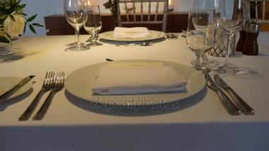 Plates at the wedding banquet. Table setting. Wedding decoration & Table Setting at Wedding Reception u2014 Stock Video © robert_g #64736767