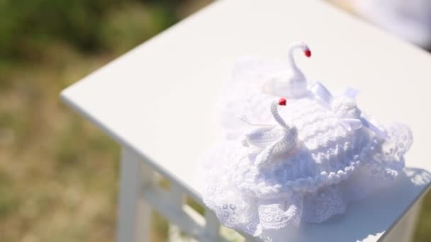 Pillow for rings with swans. Wedding decorations. Wedding in Mon