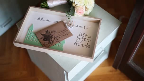 Wedding rings on an envelope with a letter with a wedding bouque