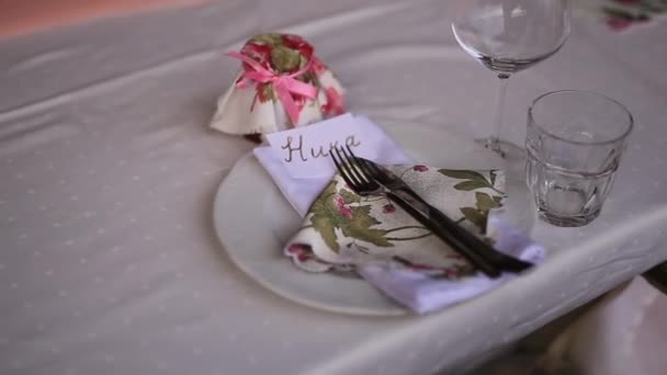 Plates at the wedding banquet table setting wedding decoration plates at the wedding banquet table setting wedding decoration stock footage junglespirit Gallery