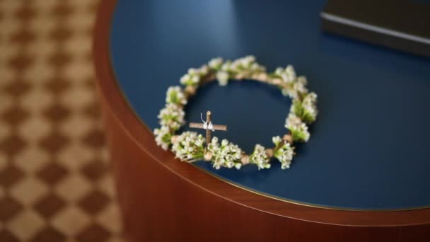 Wreath of small white flowers on the table wedding crown of the wreath of small white flowers on the table wedding crown of the stock video mightylinksfo