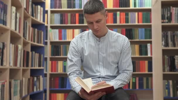 A man reads a book in the library