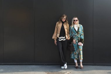 Fashionable women posing during Milan Women's Fashion Week
