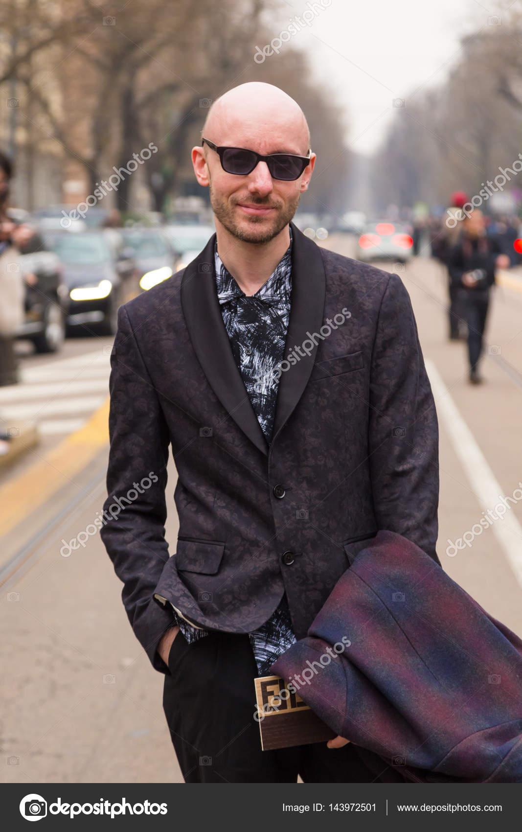 Fashionable man posing during Milan Women\u0027s Fashion Week