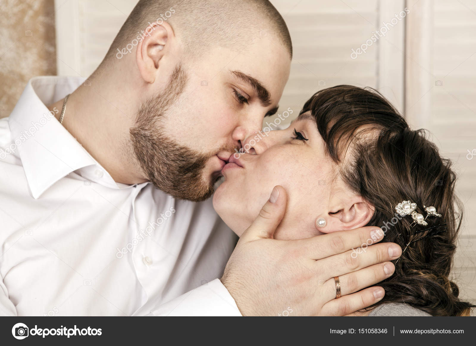 man and woman kissing on the lips