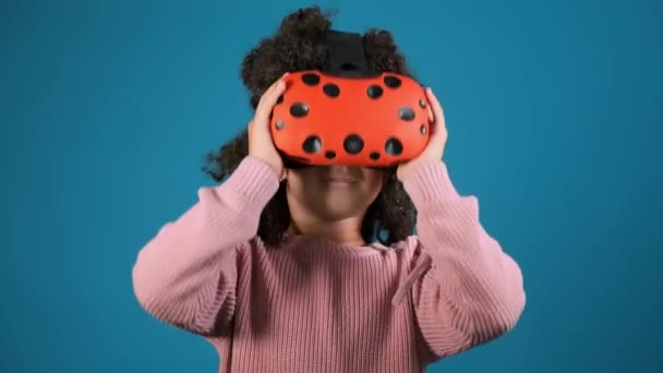 excited girl with virtual reality glasses clutches head