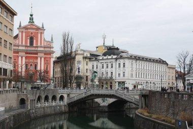 Ljubljana city in the evening. Cityscape with bridge. Slovenia winter 2019.
