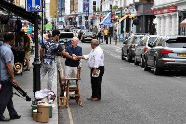 LONDON, ENGLAND - JULY 15 2017 - portobello road london street colorful marketplace