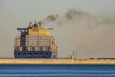 Container ship while docking in genoa harbor