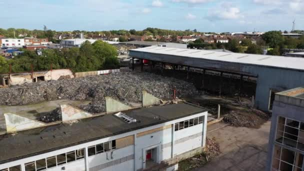 Aerial view of a warehouse destroyed by fire and filled with waste junk, Margate, Kent, UK