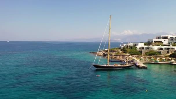 Aerial view of a yaht moored near Elounda beach, Crete, Greece