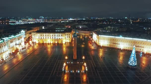 Aerial view to Palace square with Winter Palace and Alexander Column in background, St Petersburg, Russia