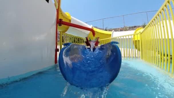 Water running down the water slide at aqua park, Crete, Greece